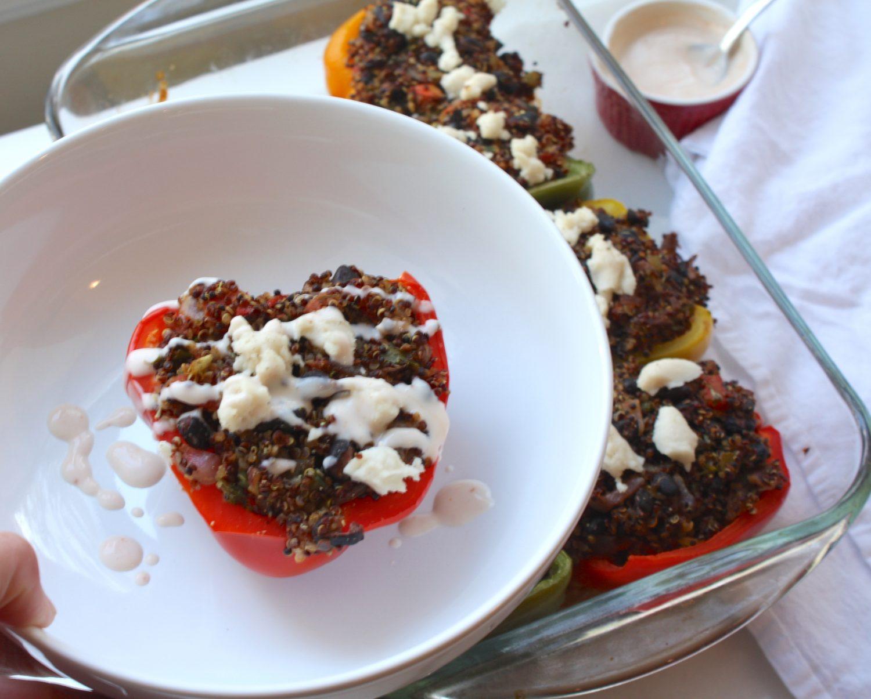 stuffed bell pepper with black bean, quinoa and cashew yogurt