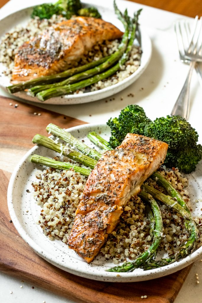 Baked salmon and asparagus over a bed of quinoa and broccoli