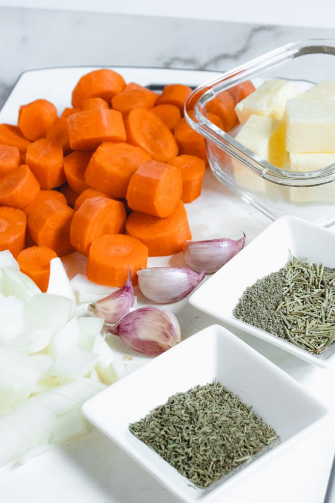 Prepping carrots, onions, garlic and herbs for the chicken